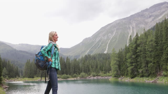 mature adult woman by lake enjoying scenic nature landscape - tyrol state austria stock videos and b-roll footage