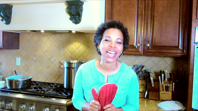 mature african american woman in kitchen talking - oven mitt stock videos and b-roll footage