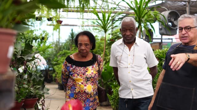 Mature African Couple Customer Buying at Flower Market