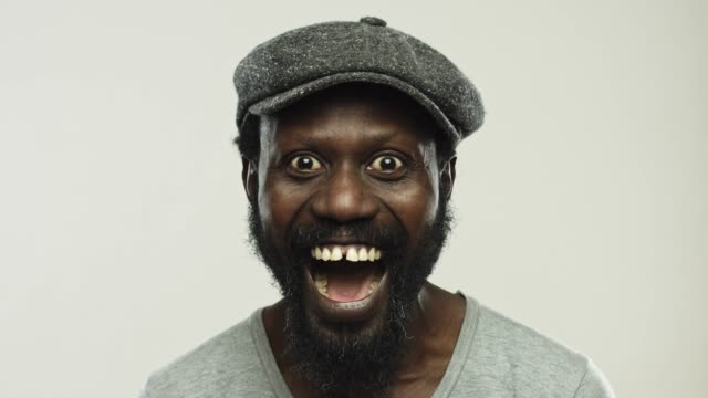 mature african man laughing and showing diverse positive expressions - eyes closed stock videos & royalty-free footage