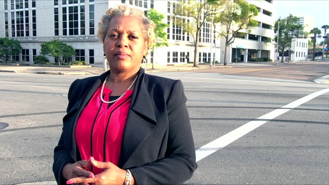 mature african-american businesswoman on city street - politician stock videos & royalty-free footage