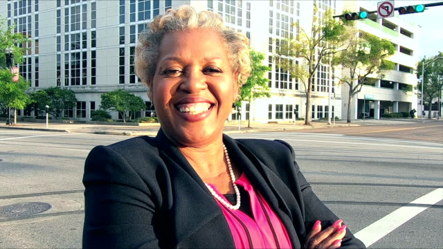 Mature African-American businesswoman on city street