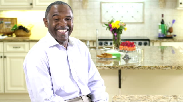 mature african-american man in kitchen, laughing - waist up stock videos & royalty-free footage