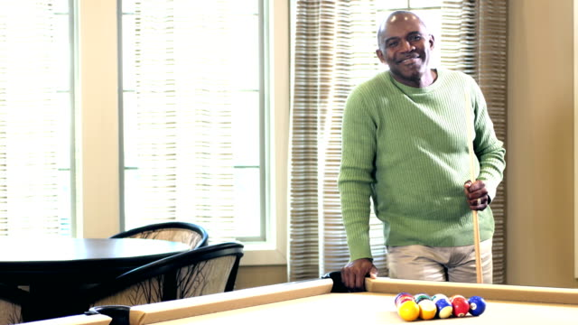 Mature African-American man ready to shoot pool