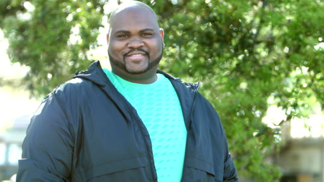 mature african-american man standing outdoors - overweight stock videos & royalty-free footage