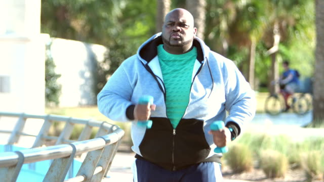 mature african-american man with large build exercising - overweight active stock videos & royalty-free footage