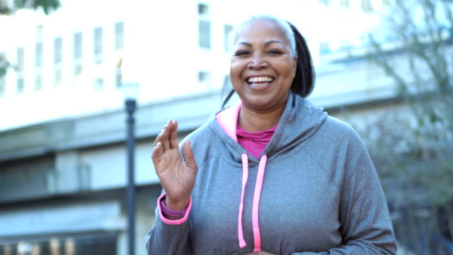 mature african-american woman in city, ready to exercise - overweight active stock videos & royalty-free footage