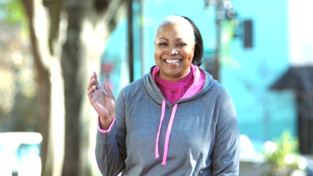 mature african-american woman in city wearing sweatshirt - 50 59 years stock videos & royalty-free footage