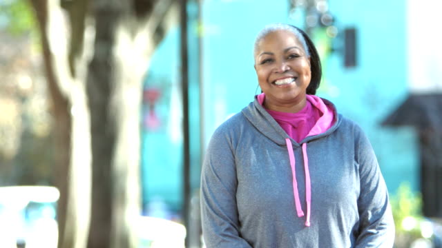 mature african-american woman in city wearing sweatshirt - sportswear stock videos & royalty-free footage