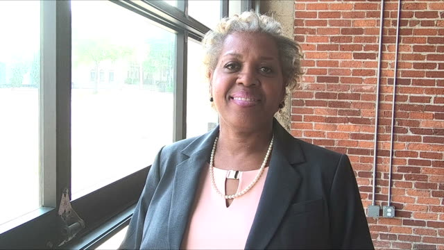 Mature African-American woman in suit standing indoors