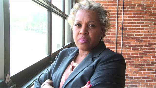 mature african-american woman in suit, stern, assertive - toughness stock videos & royalty-free footage