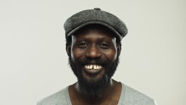 mature afro american with beard smiling - gray background stock videos & royalty-free footage