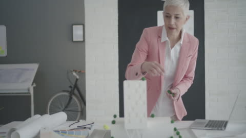 4k: mature architect working in her office. - white hair stock videos & royalty-free footage