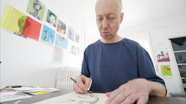 mature artist sketching. - art class stock videos & royalty-free footage