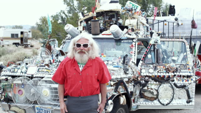 ms, mature baby boomer man standing in front of adorned truck, niland, california, usa - 2009 stock videos & royalty-free footage
