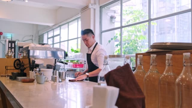 mature barista making coffee cup at bar counter - cafeteria worker stock videos and b-roll footage