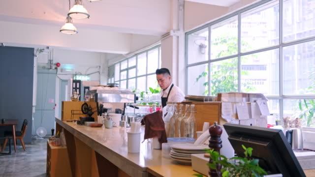 Mature barista making coffee cup at bar counter