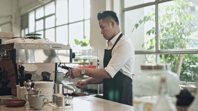 mature barista preparing coffee at cafeteria - waiter stock videos & royalty-free footage