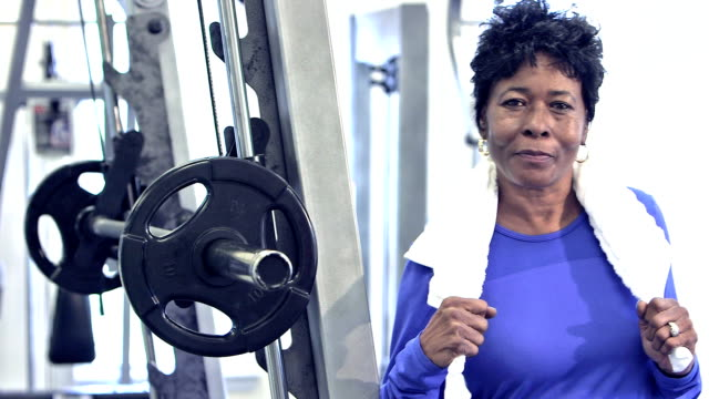 mature black woman at the gym - 50 59 years stock videos & royalty-free footage