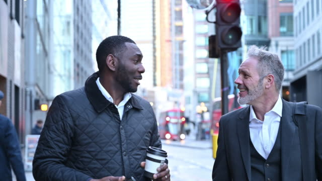 mature british businessmen walking and talking outdoors - central london video stock e b–roll