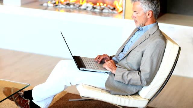 Mature business man working on laptop