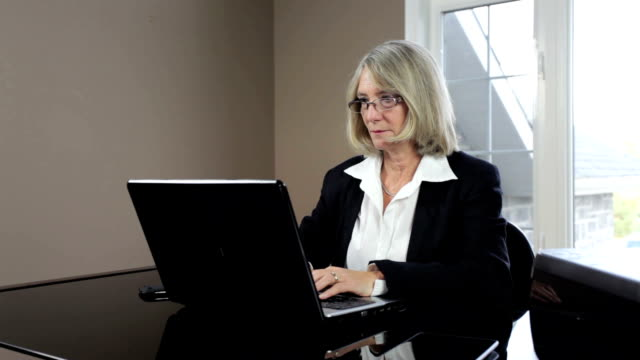 Mature business woman in office