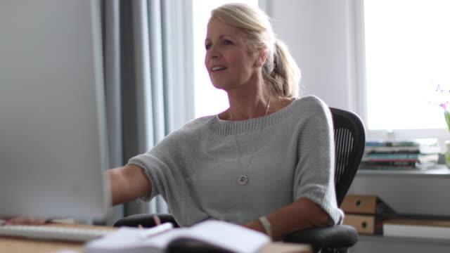Mature business woman working on desktop computer