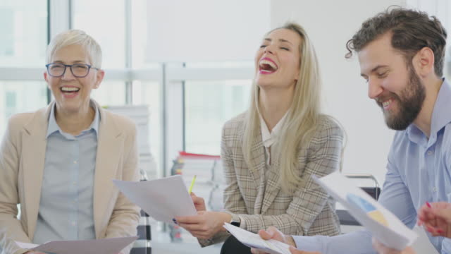 mature business women working together at the office - direttrice video stock e b–roll