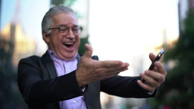 mature businessman celebrating success - celebration stock videos & royalty-free footage