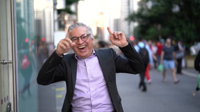 mature businessman dancing and having fun at street - friday stock videos & royalty-free footage