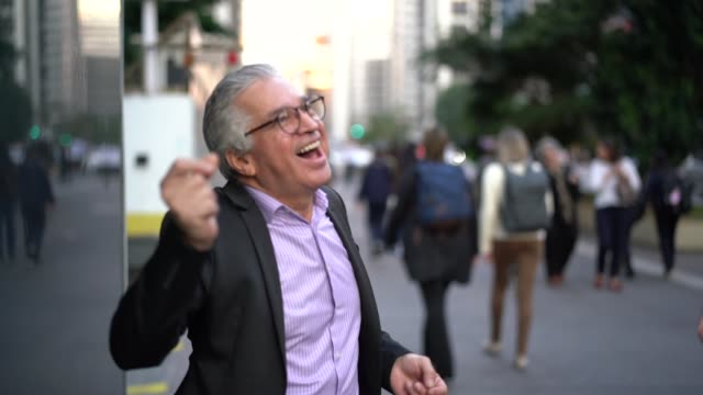 mature businessman dancing and having fun at street - cool attitude stock videos & royalty-free footage