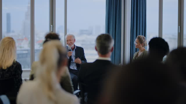 mature businessman giving an interview during a conference. q&a panel - candidate stock videos & royalty-free footage