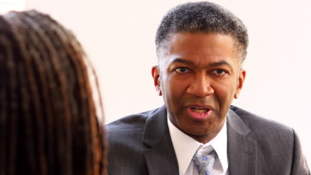 MS Mature businessman leading team meeting in office conference room