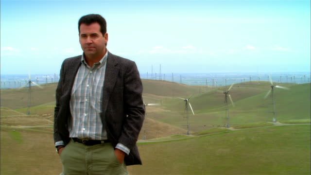 ms mature businessman standing near wind turbines on hillside / livermore, california, usa - only mature men stock videos & royalty-free footage