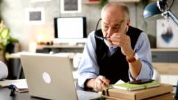 Mature businessman working in his studio