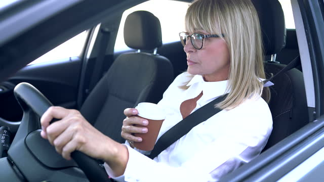 mature businesswoman at car - 50 54 years stock videos & royalty-free footage