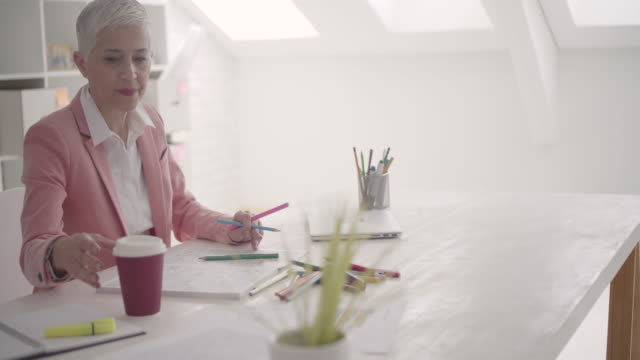 4K: Mature Businesswoman Coloring Book In Her Office.