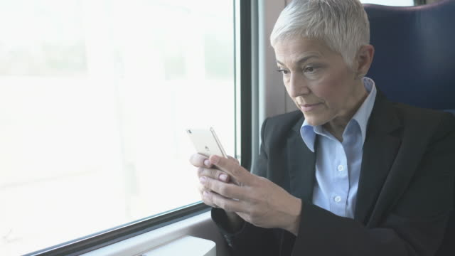 mature businesswoman in train - information sign stock videos & royalty-free footage