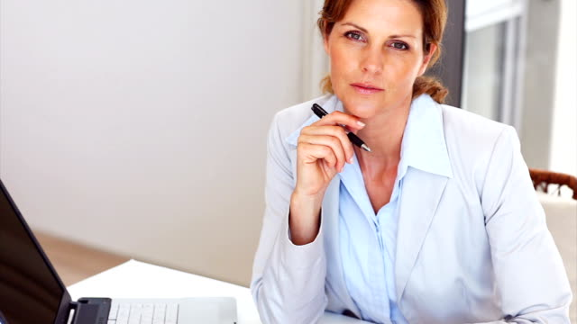 mature businesswoman smiling at work - attitude stock videos & royalty-free footage