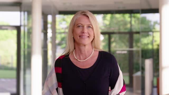 mature businesswoman with digital tablet in office - plain stock videos & royalty-free footage
