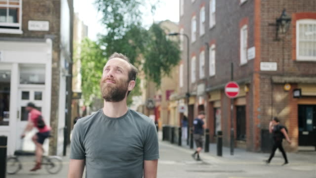 mature caucasian man with a beard walking around the park in london and admiring the view - english culture stock videos & royalty-free footage
