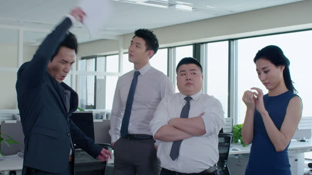 mature chinese businessman scolding employees,4k - office politics stock videos & royalty-free footage