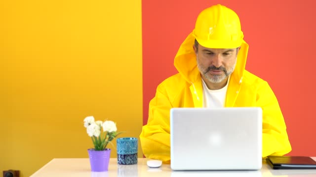 mature construction worker in the modern office - raincoat stock videos & royalty-free footage