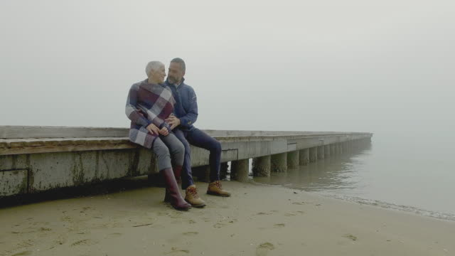 mature couple at beach - etnia video stock e b–roll