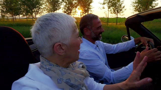 mature couple at car - convertible stock videos & royalty-free footage