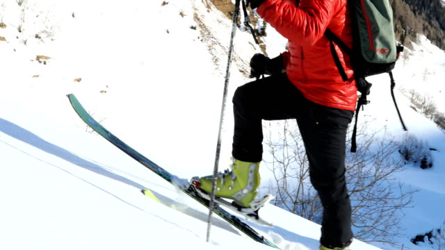 mature couple back country ski above swiss alpine towns - mature couple stock videos & royalty-free footage