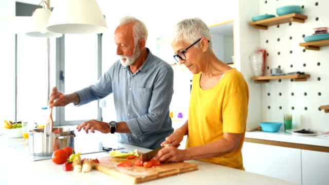 mature couple cooking lunch together. - short hair stock videos & royalty-free footage