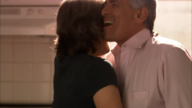 mature couple dancing in kitchen - mature couple stock videos & royalty-free footage