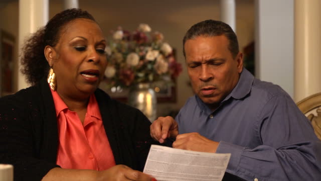 mature couple discuss financial issues - mcu - mature couple stock videos & royalty-free footage