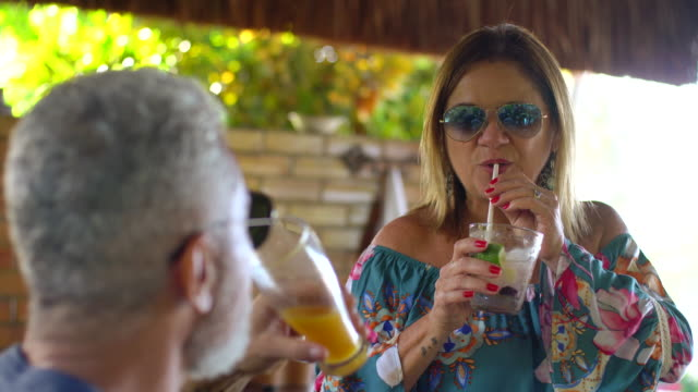 mature couple drinking tropical juice - cachaça stock videos & royalty-free footage